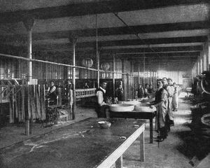 TIRE FACTORY, 1897. Workers at a wiring station at the Beeston pneumatic tire factory