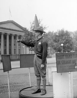TRAFFIC COP, 1918. Army officer directing traffic at the U.S. Treasury Department