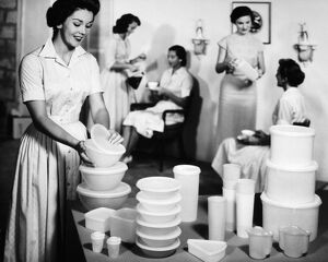 TUPPERWARE PARTY, 1950s. A Tupperware party in an American home. Advertising photograph