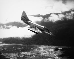 A U.S. Navy A4 Skyhawk dropping a bomb on Viet Cong forces in South Vietnam, 1965.