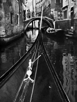 VENICE: CANAL, 1969. Bow of a gondola on a canal in Venice, Italy, 1969.