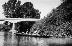 WASHINGTON: CANOE, 1921. Duwamish Native Americans transporting passengers in a