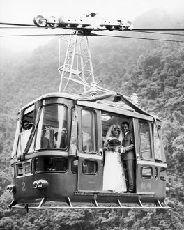 WEDDING: CABLE CAR, 1970. A young Taiwanese couple, she a cable car conductor, he