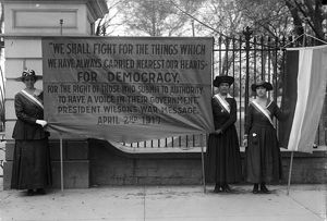 WHITE HOUSE: SUFFRAGETTES. Women suffragettes holding a banner addressing President Woodrow Wilson