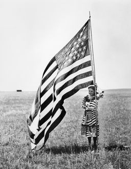 WISCONSIN: PATRIOTISM. A patriotic young woman posing with the American flag on the