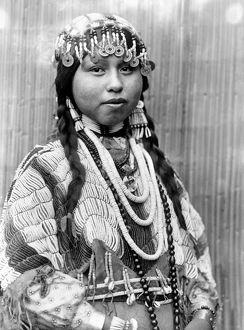WISHRAM BRIDE, c1910. Half-length portrait of a Wishram (Tlakluit) bride with braids