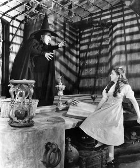 WIZARD OF OZ, 1939. Margaret Hamilton as the Wicked Witch of the West and Judy Garland