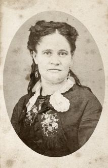 WOMAN, c1880. Portrait of a woman. Carte de visite from a photography studio in Chicago