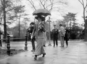 WOMAN, c1913. A woman carrying an umbrella, possibly in Washington, D.C. Photograph