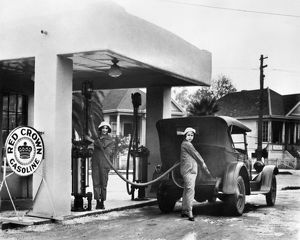 Two women working at a gas station in California. Photograph, c1925.