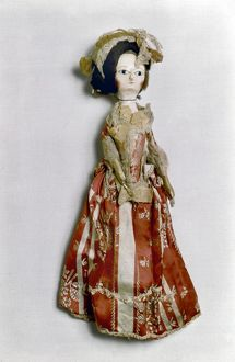 Wooden doll with silk dress, English, c1770.