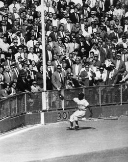 WORLD SERIES, 1955. Left fielder Sandy Amoros of the Brooklyn Dodgers catches a deep