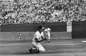 WORLD SERIES, 1970. Brooks Robinson, third baseman for the Baltimore Orioles, kneels