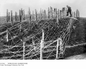 WORLD WAR I: BARBED WIRE. German soldiers fixing a barbed wire tangle on a battlefield