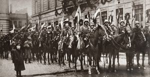 WORLD WAR I: BERLIN, C1918. Squadron of Prussian Cavalry with decorated flagstaffs