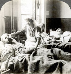 WORLD WAR I: NURSE. A nurse tending to a badly wounded soldier at a hospital in Antwerp