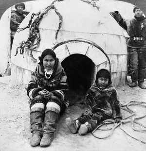 WORLD'S FAIR: ESKIMOS. An Eskimo woman and a young boy sitting outside of an exact