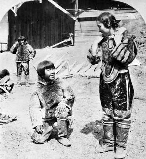 WORLD'S FAIR: ESKIMOS. A woman dressed as an Eskimo standing next to a young