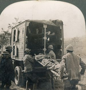 WW I: WOUNDED/MEDICS. Taking away the wounded in motor ambulances; Somme, France.