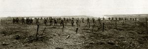 WWI: YPRES, 1917. Canadian troops advancing through German entanglements on a battlefield