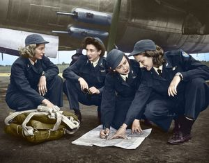 digitally colorized/wwii women pilots c1941 female pilots looking chart
