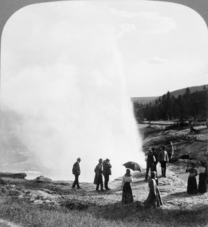 YELLOWSTONE PARK: GEYSER. Spectators watching a geyser eruption in Yellowstone National Park
