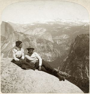 YOSEMITE VALLEY, c1902. A couple seated on a rock at the top of the cliff in Yosemite National Park