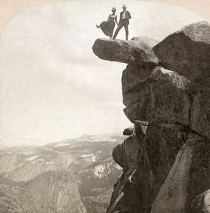 YOSEMITE VALLEY, c1902. A couple standing on a rock at the top of the cliff with