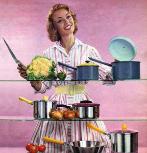 Happy Housewife in Kitchen 1960s UK pans pots housewives