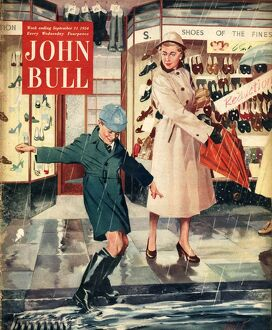 John Bull 1954 1950s UK mothers sons raining puddles umbrellas shopping wet weather