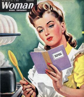 Woman 1942 1940s UK cooking women at war housewives reading recipes housewife woman