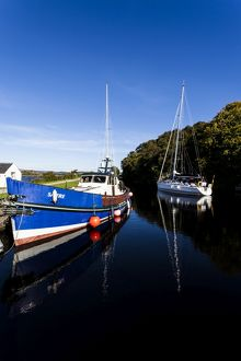 Two boats in the Crinan Canal, Scotland.