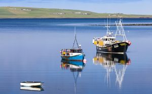 Boats in the Weddell Sound, Orkney in Scotland.