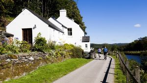 Cyclists beside the Crinan Canal, Scotland.