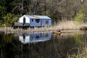 A kayaker on the Crinan Canal, Argyll & Bute, Scotland