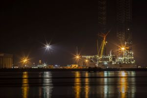 A night-time view of the fabrication yard at Nigg Point in Scotland.
