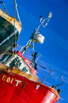 The reflection of a fishing boat at Tarbert, Argyll & Bute, Scotland