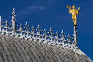The roof and golden statue on the Ypres Cloth Hall in Belgium