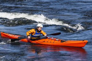 A sea kayaker at the Falls of Lora at Connel in Scotland.