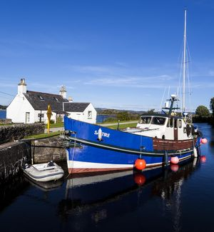 A ship in the Crinan Canal, Scotland.