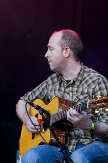 Tony Byrne of the Julie Fowlis Band playing at Oban Live in Scotland