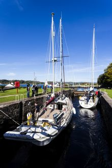 Two yachts in the Crinan Canal, Scotland.