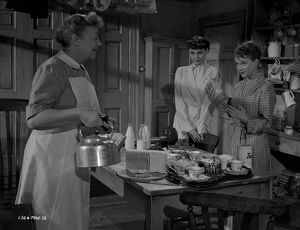 Athene Seyler, Audrey Hepburn and Joan Greenwood in a kitchen scene in Young Wives&#39