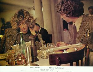 Julie Christie and Donald Sutherland in a front of the house image for Don't Look Now