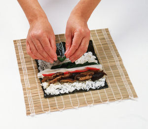 1 - Place a lightly toasted nori sheet on a bamboo mat