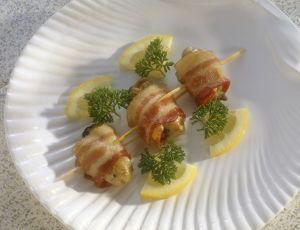 Angels on horseback, oysters wrapped in bacon and garnished with lemon and parsley