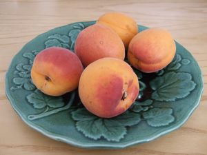 Apricots and peaches on plate