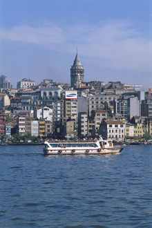 Asia, Turkey, Istanbul, passenger ferry passing the waterfront of Karakoy below the Galata Tower