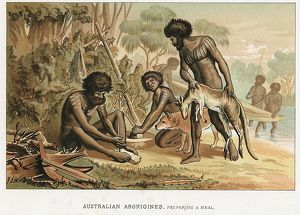 Australian natives preparing meal from animal they have hunted. Man on left makes