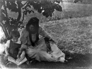 Beatrice Baxter Ruyland and Charles O'Malley, as a child with a book in his lap